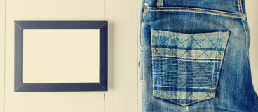 Blank Picture frame with vintage Jean. Royalty Free Stock Photo