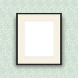 Blank picture frame on vintage style wallpaper Royalty Free Stock Photography
