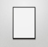 Blank picture frame. At the wall with copy space and clipping path for the inside Royalty Free Stock Photography