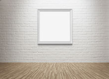 Blank picture frame at the wall Royalty Free Stock Image