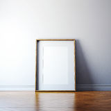Blank picture frame on a wall. Blank picture frame and sunlight on a wall Stock Photos