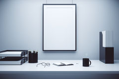 Blank picture frame on a wall and table with glasses, diary and Royalty Free Stock Images