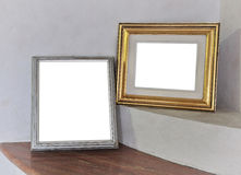 Blank picture frame on white wall Stock Images