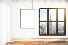 Blank picture frame on white wall in loft empty room with city v Stock Images