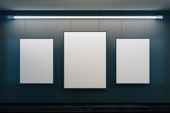 Blank picture frames on black walls with black wooden floor, moc Royalty Free Stock Photo