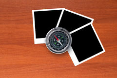 Blank Picture Frames and Compass. Blank, black picture frames with compass on wooden table Royalty Free Stock Photos