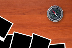 Blank Picture Frames and Compass. Blank, black picture frames with compass on wooden table Royalty Free Stock Photography