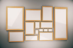 Blank picture frames composition on the wall Royalty Free Stock Image