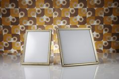 Blank picture frames, gold. Blank picture frames against kitsch background Stock Photography
