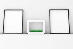 Blank Picture Frames with Grass in White Ceramics Planter on the Royalty Free Stock Photos