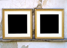Blank picture frames. With passe-partout on wooden shelf on a background of white shabby wall Stock Photos