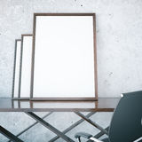 Blank picture frames on table Royalty Free Stock Photos