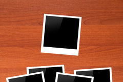 Blank Picture Frames on Wooden Table Stock Photo