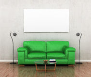 Blank picture on the grey wall near the green sofa. Royalty Free Stock Photo