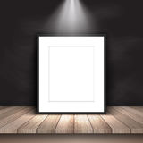 Blank picture leaning against chalkboard Stock Images