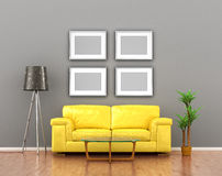 blank pictures on the gray wall weigh over the yellow sofa. Royalty Free Stock Photography