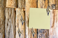 Blank piece of paper attached on an old wooden wall with Japanese ninja concealed weapons. Royalty Free Stock Image