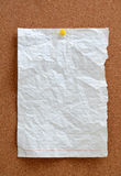 Blank piece paper pinned into corkboard Royalty Free Stock Images