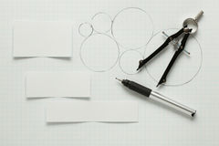 Blank pieces of paper with pen & compass Royalty Free Stock Image