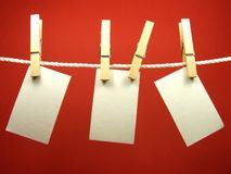 Blank pieces of paper on rope. Blank pieces of paper hang on clothesline Royalty Free Stock Image