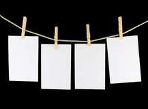 Blank pieces of paper and wooden clothespins Royalty Free Stock Photos
