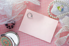 Blank pink card for congratulations with  ring. Stock Photography