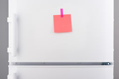 Blank pink paper note and pink sticker on white refrigerator Stock Photography