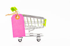 Blank pink paper price tag with shopping cart. Royalty Free Stock Photo