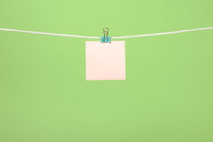 Blank pink paper sheets hanging on string Stock Images