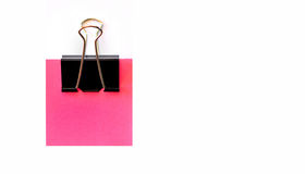 Blank pink post it. A blank pink post it on white background with a clip attached - copy space Royalty Free Stock Photography