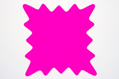Blank pink star burst isolated on white. Stock Photo