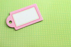 Blank pink tag on green Royalty Free Stock Images