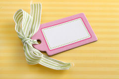 Blank pink tag on yellow Stock Images