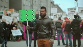 Blank placard political protest. Tracking point green screen. Political rally 4k