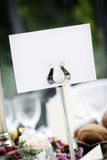 Blank Place Card. White place card for seating, in a silver holder on a wedding table. Card is blank Stock Photography