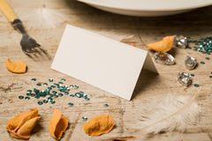 Blank Place Card Alongside Sequins, Petals, and Gemstones Royalty Free Stock Photo