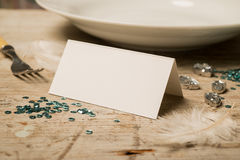 Blank Place Card by a Plate, Fork, and Green Sequins Royalty Free Stock Photos
