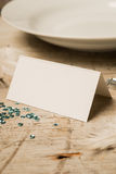 Blank Place Card by a Plate, Gemstones, and Green Sequins Stock Image