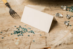 Blank Place Card Surrounded by Feathers, Gemstones, Fork, and Se Royalty Free Stock Photos
