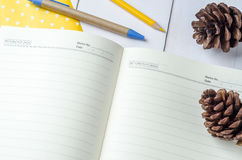Blank daily planner notebook with pen and color pencil Stock Photos