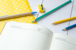 Blank daily planner notebook with pen and color pencils Stock Photography