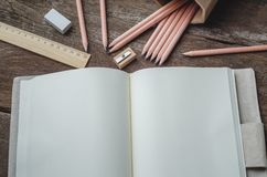 Blank daily planner notebook with pencils,  pencil sharpener, ru Stock Images