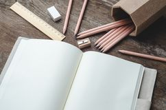 Blank daily planner notebook with pencils,  pencil sharpener, ru Stock Photos