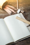 Blank daily planner notebook with pencils,  pencil sharpener, ru Royalty Free Stock Image