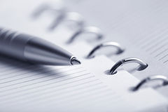 Blank planner and pen Stock Image