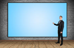 Blank plasma panel. Businessman pointing at blank plasma panel Stock Image