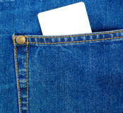 Blank plastic card in a blue jeans pocket. Royalty Free Stock Images