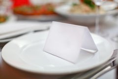 Blank plate and card for guests in restaurant Stock Image