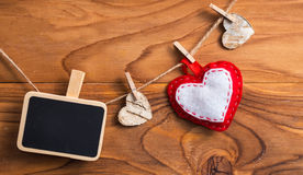 Blank plate for writing text with hearts on the clothespin.Symbo Royalty Free Stock Photography