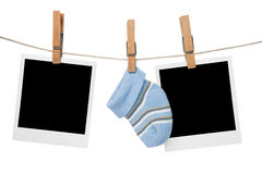 Blank polaroid family photo frames. Hanging on line Stock Photography